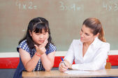 Chinese girl learning math with teacher — Stock Photo