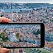 Male hand with smartphone taking a picture of Istanbul. Tourism — Stock Photo #70536041