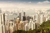 HONG KONG - APRIL 15, 2014: Hong Kong skyline on a spring day. H — Foto de Stock