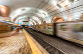 Blurred fast moving train in Rome subway — Stok fotoğraf