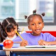 Afro american and chinese students at primary school — Stock Photo #72779601