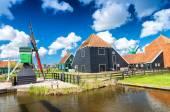 Zaanse Schans windmills along city canal, Netherlands — Stock Photo