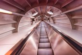 Moving blurred picture of escalator inside a tunnel — Stock Photo