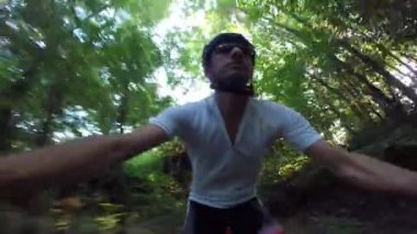 Cyclist rides a mountain bike in a forest — 图库视频影像
