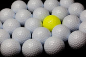 Alternative: Single yellow ball mixed with many white balls — Stock Photo