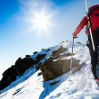 Climberr walking up along a steep snowy ridge with the skis in t — Stock Photo #59322125