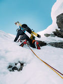 Ice climbing: mountaineer on a mixed route of snow and rock duri — Foto Stock