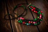 Fabric necklace of colourful flowers with the metal lock — Stock Photo