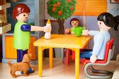 Little plastic toys. Mom prepares to eatLittle plastic toys. Mom prepares to eat — Stock Photo