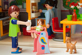 Little plastic toys. Family on the kichen — Stock Photo