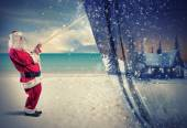 Santa Claus pulls the winter — Stockfoto