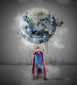 Little superhero saves the world — Stock Photo
