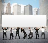 Business people holds blank banner — Stock Photo