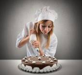 Pastry cook prepares a cake — Stock Photo