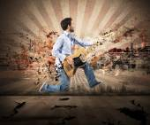 Man jumping with bass guitar — Foto Stock