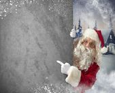 Santaclaus indicates billboard — Stock Photo