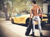 Mechanic repairs a luxury car — Stock Photo