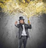 Man with champagne bottle and glass — Stock Photo
