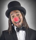 Elegant clown with red nose — Stock Photo