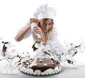 Pastry cook prepares cake — Stock Photo