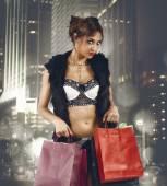 Beautiful woman buying fashionable clothes — Stock Photo