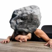 Woman crushed by the weight of stone — Stock Photo