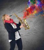 Woman plays saxophone — Stock Photo