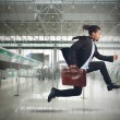 Businessman runs in the airport — Stock Photo #63052769