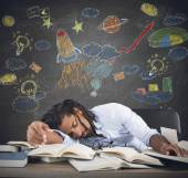 Teacher sleeping on desk — Stock Photo