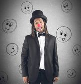 Man grimacing with clown nose — Stock Photo