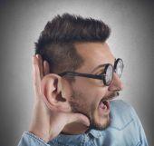 Nerd man listens gossip — Stock Photo