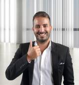 Businessman showing thumb up — Stock Photo