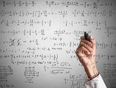 Woman solves mathematical calculation — Stock Photo