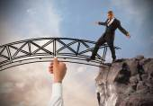 Businessman overcome an obstacle — Stock Photo