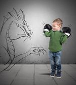 Small boxer defeat a dragon — Stock Photo