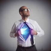 Businessman becomes a super hero — Stock Photo