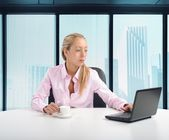 Businesswoman in her office — Stock Photo