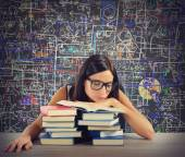 Bored student reads books — Stock Photo