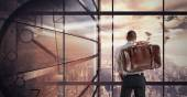 Businessman looks at window — Stock Photo