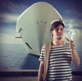 Sailor smokes in front of ship — Stock Photo
