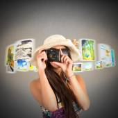 Woman tourist shows pictures — Stock Photo