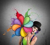 Clown with rainbow helix — Stock Photo