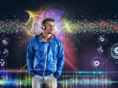 Boy listens to music — Stock Photo