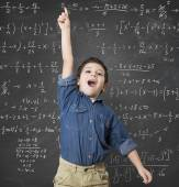Child solves mathematical calculation — Stock Photo