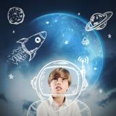 Child daydreams to be astronaut — Stock Photo