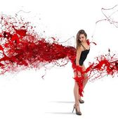Woman in red plume — Stock Photo