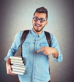 Boy nerd studying books — Stock Photo