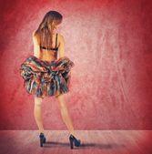 Girl in red room — Stock Photo