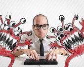 Businessman eradicate computer from viruses — Stock Photo