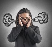 Businessman with brain in smoke — Stock Photo
